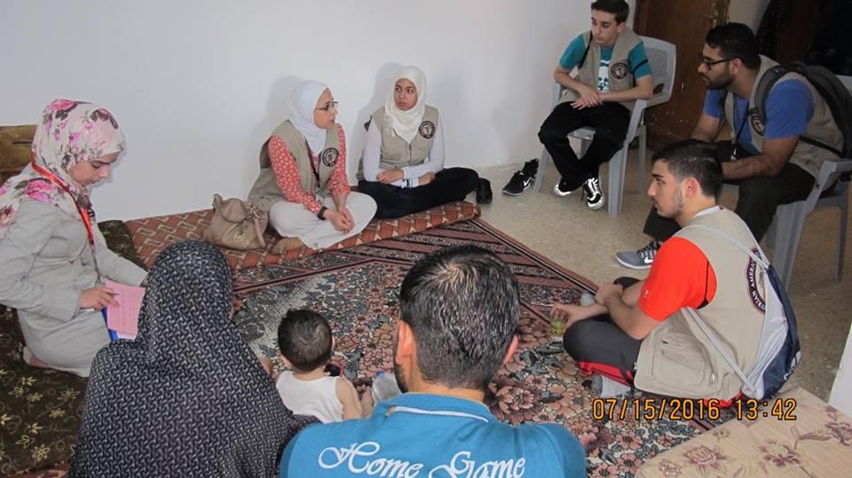 Volunteers Meet with Families