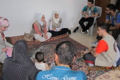 Volunteers Meet with Families